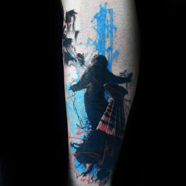 Blue And Black Ink Guys Trash Polka Tattoo On Leg