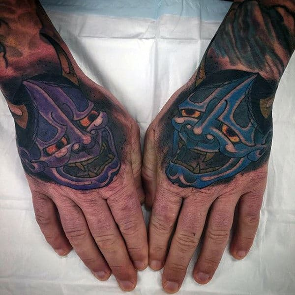 Blue And Purple Hannya Masks Tattoos On Mans Hands