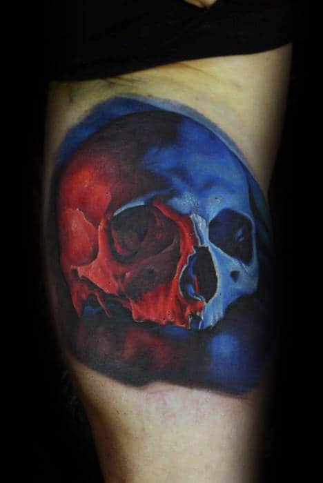 Blue And Red Ink Realistic Skull Mens Inner Arm Bicep Tattoo