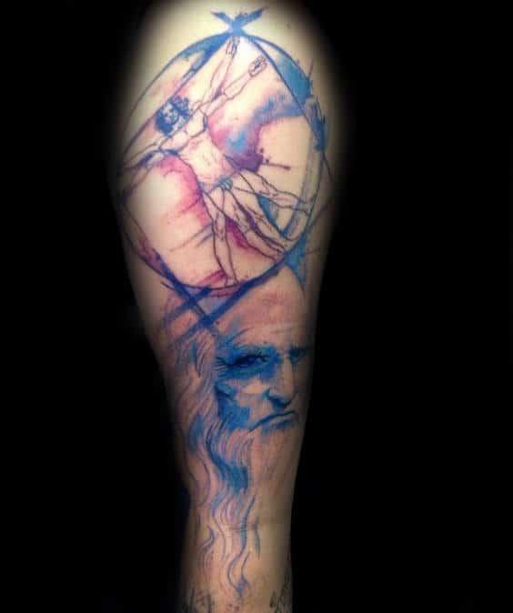 Blue And Red Vitruvian Man Male Tattoo With Leonardo Da Vinci Portrait Design On Arm