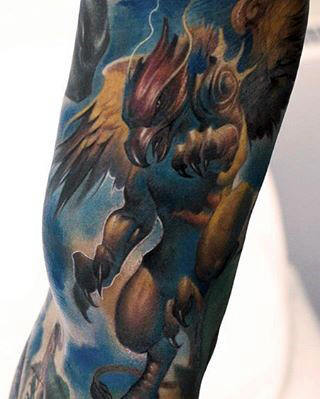 Blue And Yellow Griffin Sleeve Guys Tattoo Design Ideas