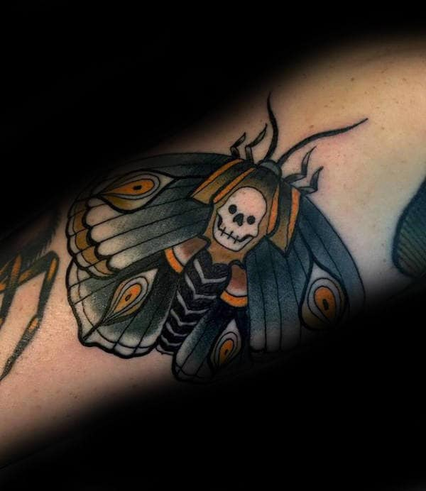 Blue And Yellow Guys Moth Arm Tattoos