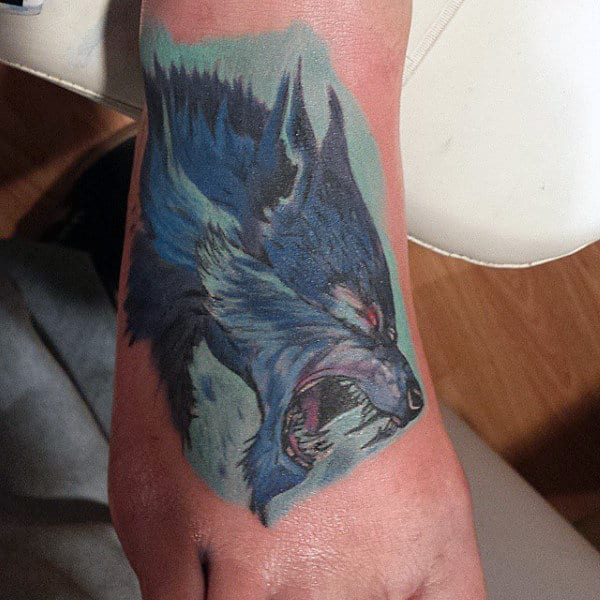 Blue Colored Werwolf Tattoo Profile View On Mens Hands