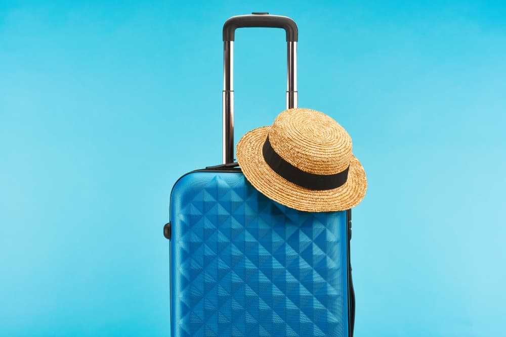 blue colorful travel bag isolated on blue background