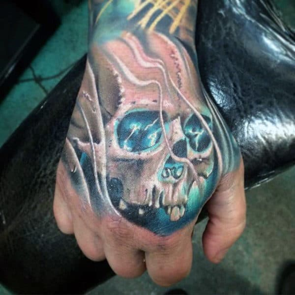 Blue Glowing Skull Male Hand Tattoo Designs