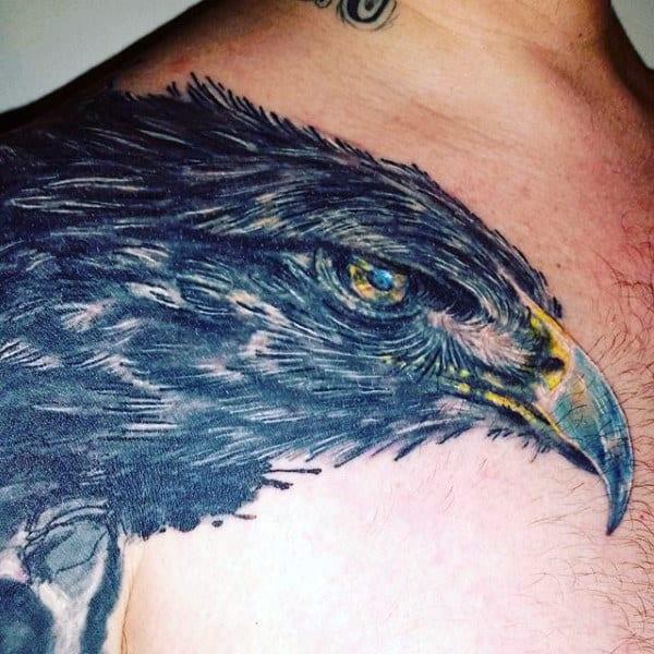 Blue Guy's Eagle Tattoo On Shoulder