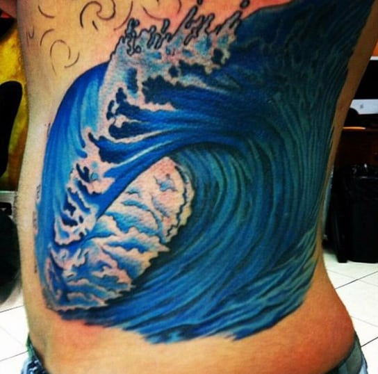 Blue Guy's Hokusai Wave Tattoo On Ribs