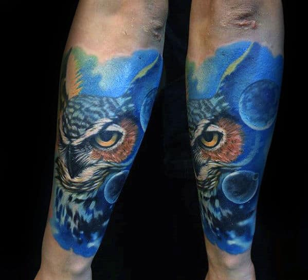 Blue Ink Background With Planets And Owl Head Mens Forearm Tattoo