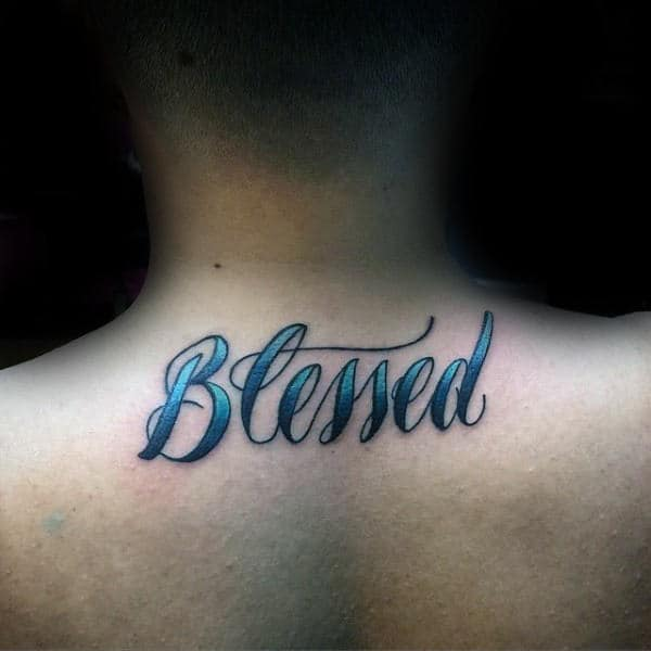 Blue Ink Blessed Word Tattoo On Mans Upper Back