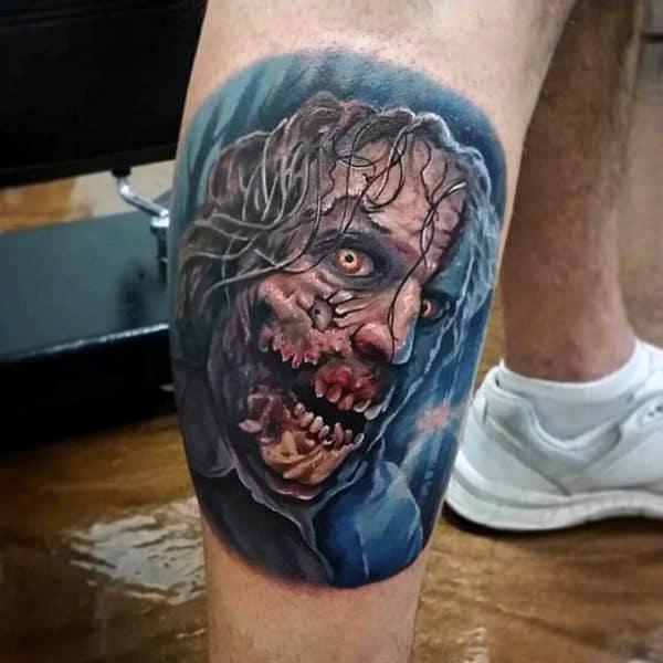Blue Ink Mens Leg Calf Zombie Portrait Tattoos