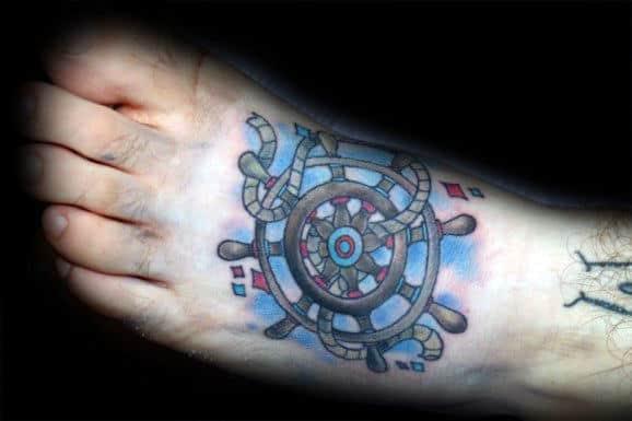 Blue Mens Ship Wheel Tattoo On Foot