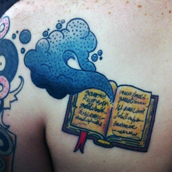 Blue Smoke Coming Out Of Open Book Tattoo Male Chest