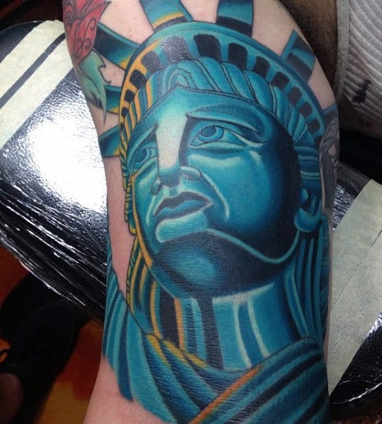 Blue Statue Of Liberty Tattoo On Mens Bicep