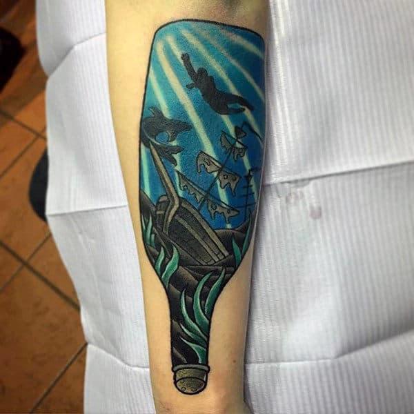 Blue Sunken Ship In A Bottle Tattoo On Mans Inner Forearm