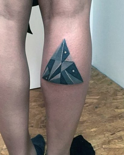 Bluish Pointed Traingular Design Tattoo On Calves