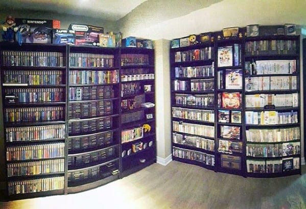 Bookcases With Video Gaming Titles Mens Man Cave Designs