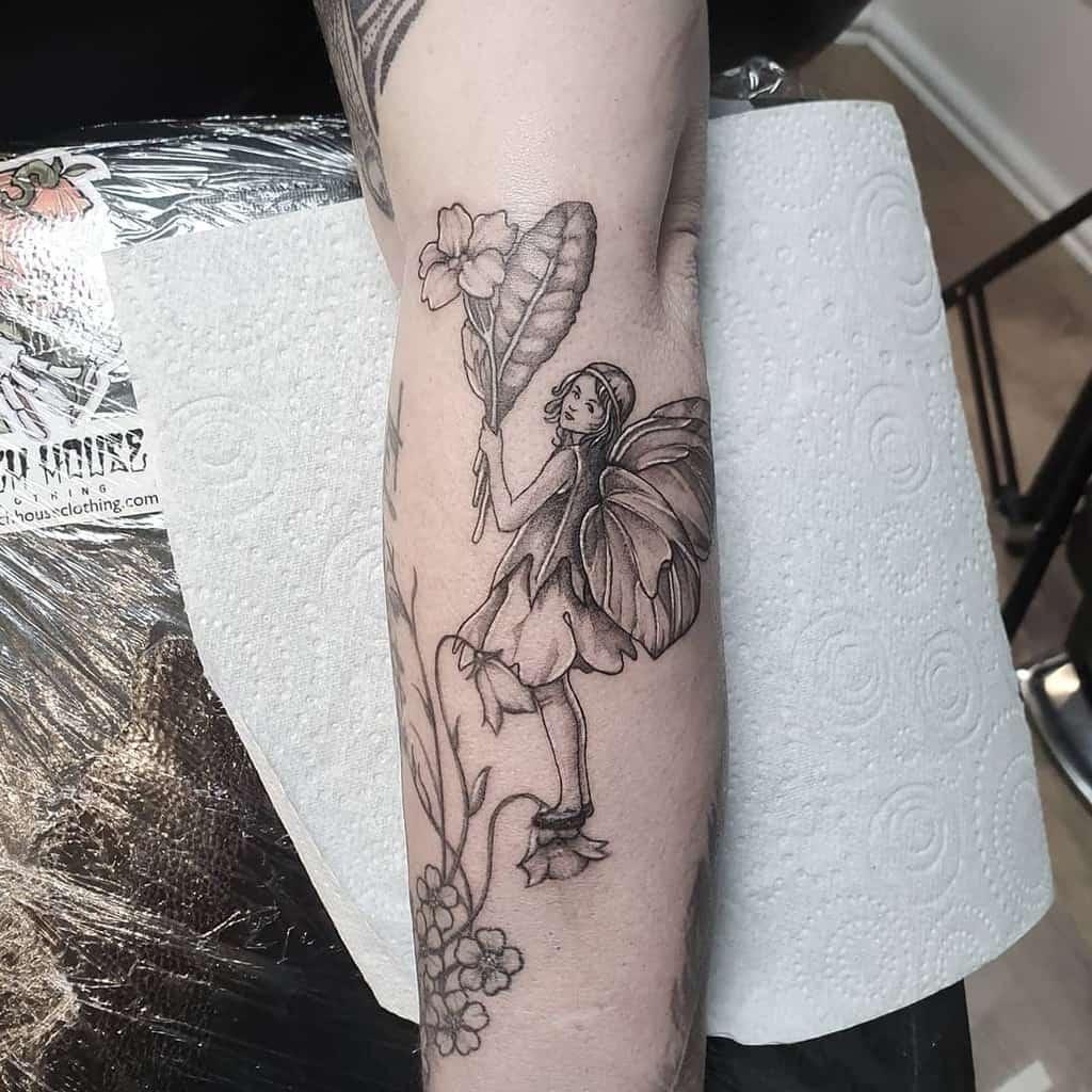 Botanical Whimsical Flower Fairy Tattoo