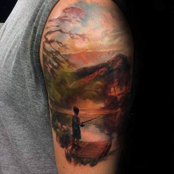Boy Fishing At Lake Landscape Male Upper Arm Tattoo With Watercolor Designs