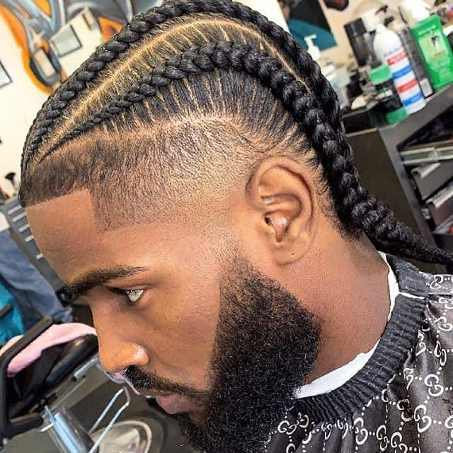 A burst fade haircut with four light braids and clean cut hairline