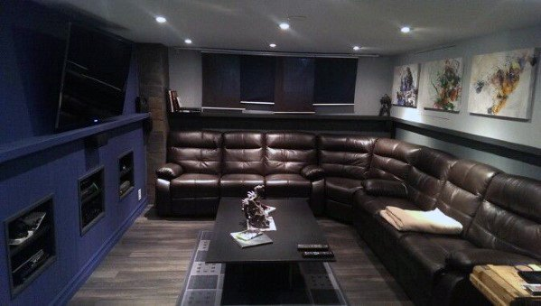 Brown Leather Sectional With Navy Wall Basement Man Cave