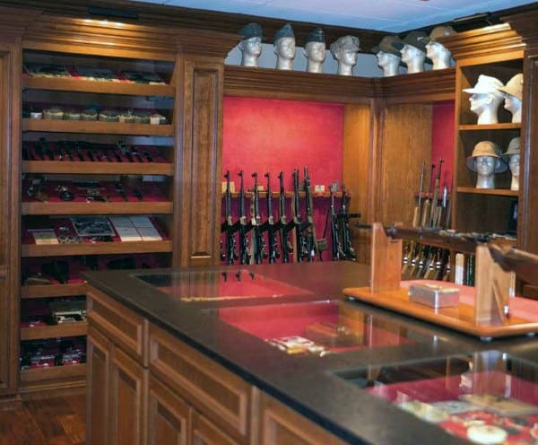 Brown Wood Cabinetry Custom Gun Room