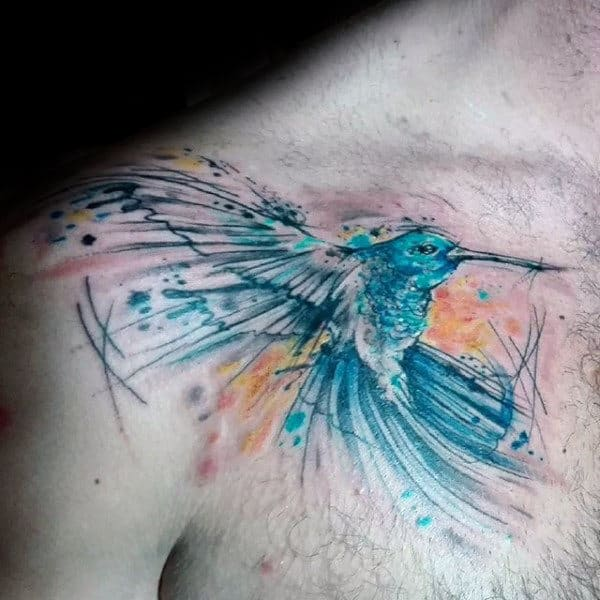 Brush Stroke Guys Hummingbird Watercolor Tattoo On Upper Chest With Blue Ink Design