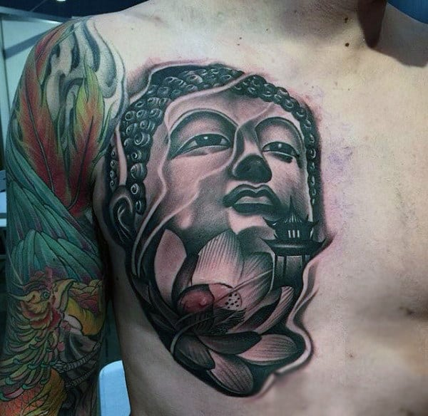 Buddha Head Tattoo With Green Leaves On Chest For Men