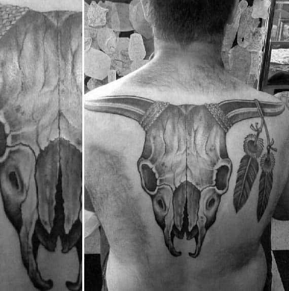 Bull Skull With Two Feathers Male Back Tattoo