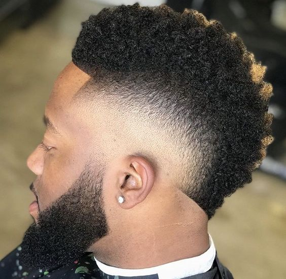 Frohawk hairstyle with a burst look around the ears