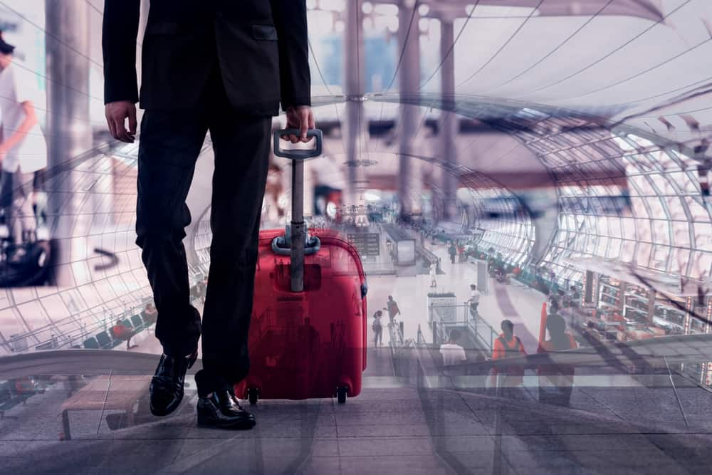 businessman with suitcase in the airport departure lounge