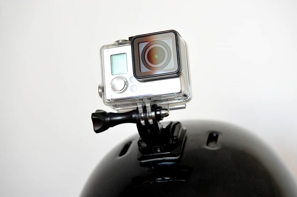 action camera mounted on black sports helmet with waterproof box