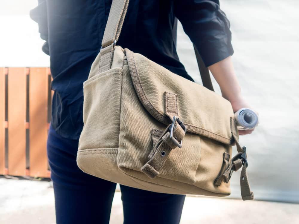 Woman traveler with canvas shoulder bag