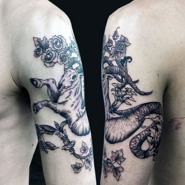 Capricorn Mens Arm Tattoo With Black Ink Floral Design