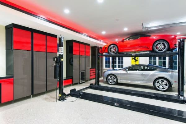 Car Lift In Home Garage With Two Tone Cabinets For Storage