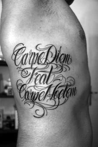 Carpe Diem Carpe Noctem Tattoo On Mans Ribs