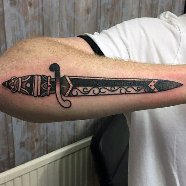 Carved Dagger Tattoo For Guys On Outer Forearm