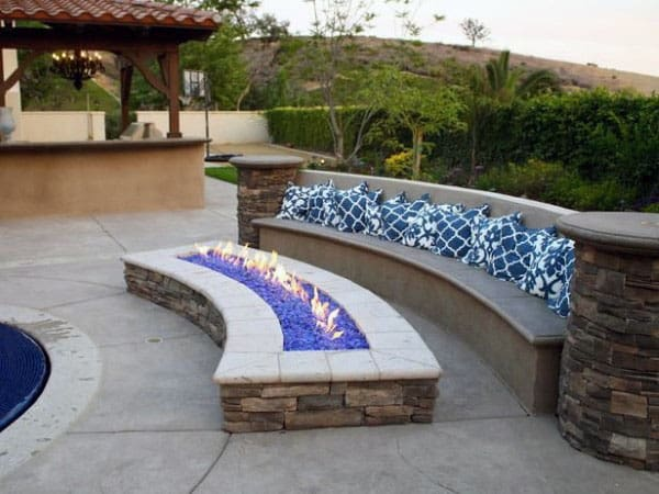 Cement Seating With Raised Stone Fireplace