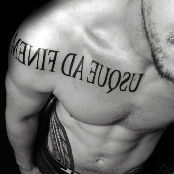 Chest And Arm Latin Tattoo On Men