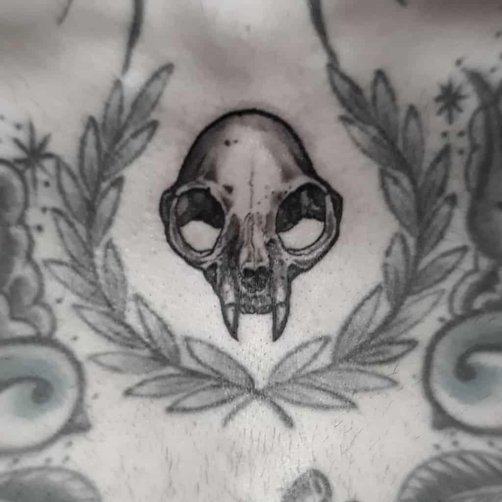 chest cat skull tattoo elenazahera_tattooandbones