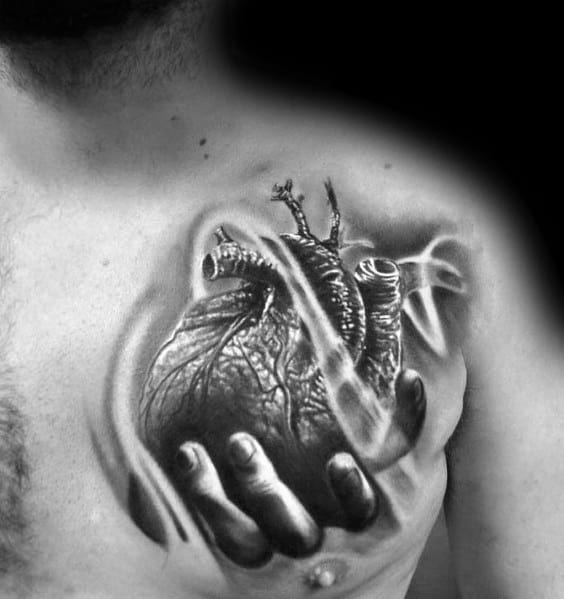 Chest Hand Holding 3d Heart Male Tattoos