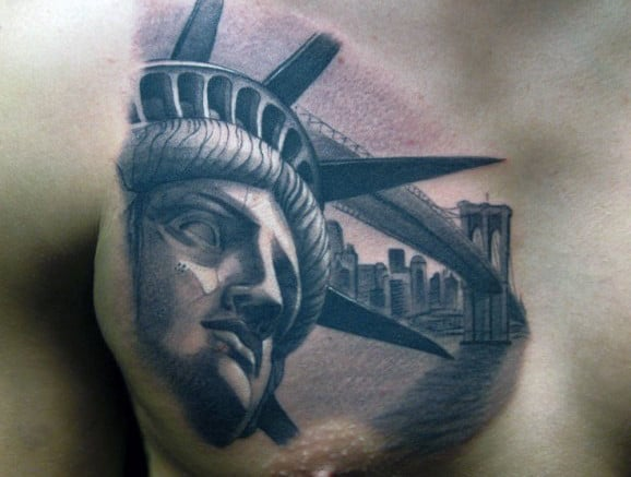 Chest Statue Of Liberty Tatto With New York City In Background
