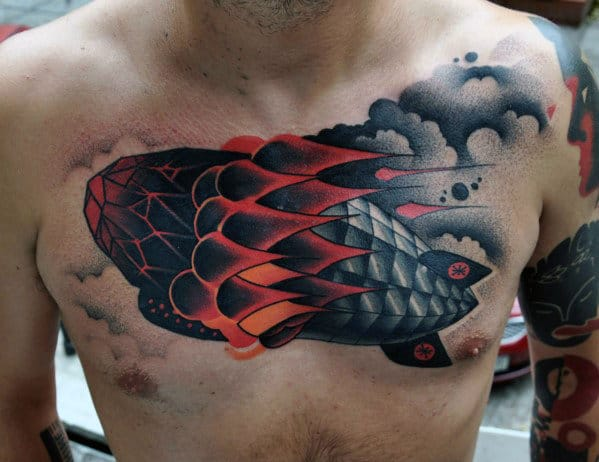 Chest Tattoo Of Rocket In Clouds For Men