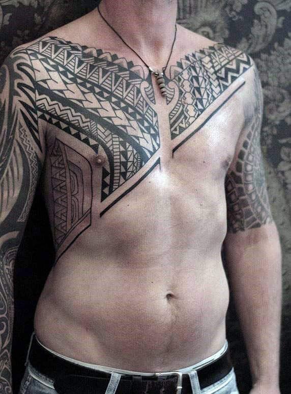 Chest To Arm Tribal Tattoos On Guy