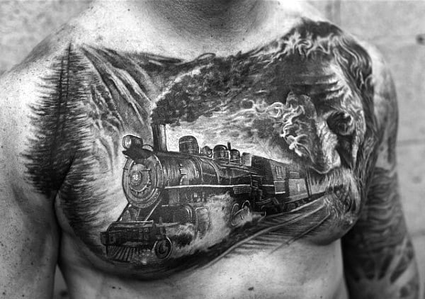 Chest Train Tattoo On Man With Mountains