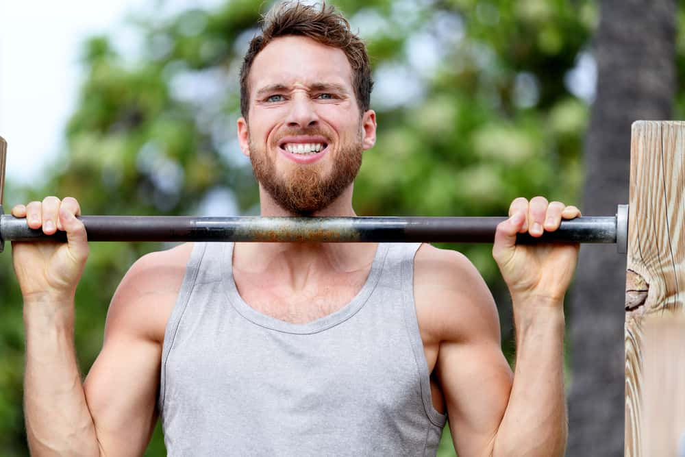 crossfit fitness man exercising chin ups workout