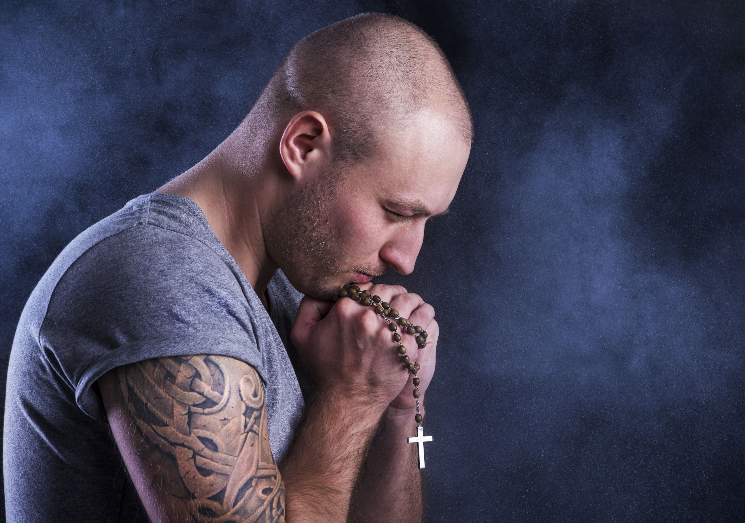 Christian Man Tattooed With Rosary Praying Hands