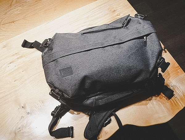 Chrome Industries Summoner Backpack Review On Wood Table