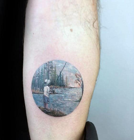 Circle Badass Small Mens Boy Fishing At Lake Tattoo On Outer Forearm