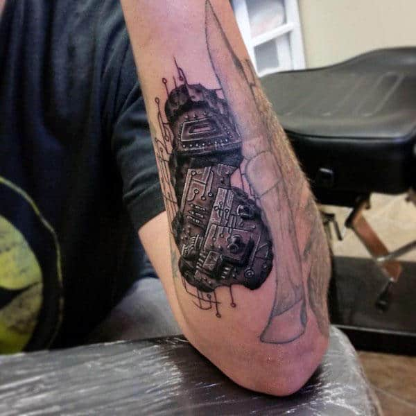 Circuit Board Pieces Tattoo On Mans Forearm