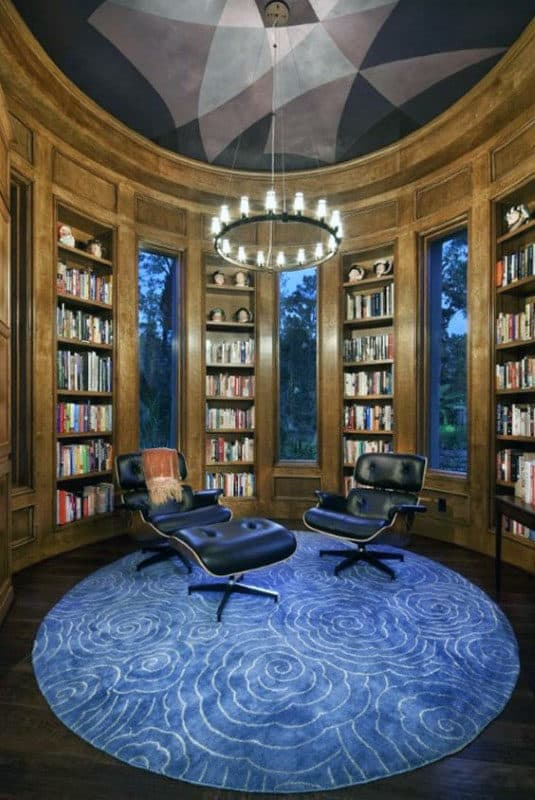 Circular Home Library Room With Wood Cabinets And Blue Decor